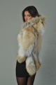 GOLDEN ISLAND FOX FUR COAT WITH HOOD ON DARK HAIRED MODEL WITH MINI DRESS