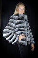 chinchilla jacket  with pelts stitched horizontally on blond model profile view