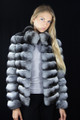 chinchilla fur jacket on model , waist length , matched  with white blouse and black pants