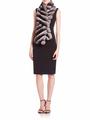 chinchilla scarf worn with black elegant knee-length dress and minimalistic heels