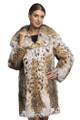 knee length lynx fur coat with hood ending on v-neck collar , tapered waist , on model wearing mini skirt and black leather heels