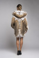 back view of hooded lynx fur coat on model with fox on the luscious hood