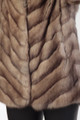 zoom vie on light brown sable fur coat with emphasis on stitching , color and texture