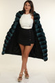 turqoise chinchilla coat on hot model with white sleeveless silk shirt , black buttoned mini skirt and high heels