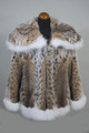 lynx fur coat with luscious shoulder covering collar , accentuated  white fox fur trim around collar , cuffs and bottom sweep