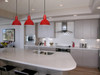 "Lifestyle View of 10"" Blackspot LED Pendant Light in Cherry Red"