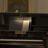 "22"" Piano lamp mounted on a piano"