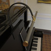"""Closer look of 22"""" Piano lamp mounted on a piano"""