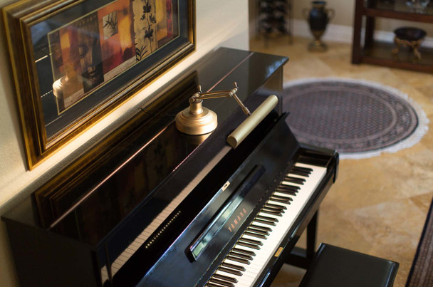 """Lifestyle View of 14"""" LED Piano Desk Lamp- Antique Brass"""