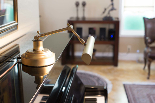 """Lifestyle Side View of 14"""" LED Piano Desk Lamp- Antique Brass"""