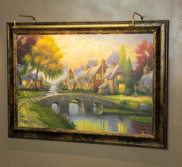 Example: Battery-Operated 12'' Tru-Slim LED Picture Light - Antique Brass Mounted on Painting
