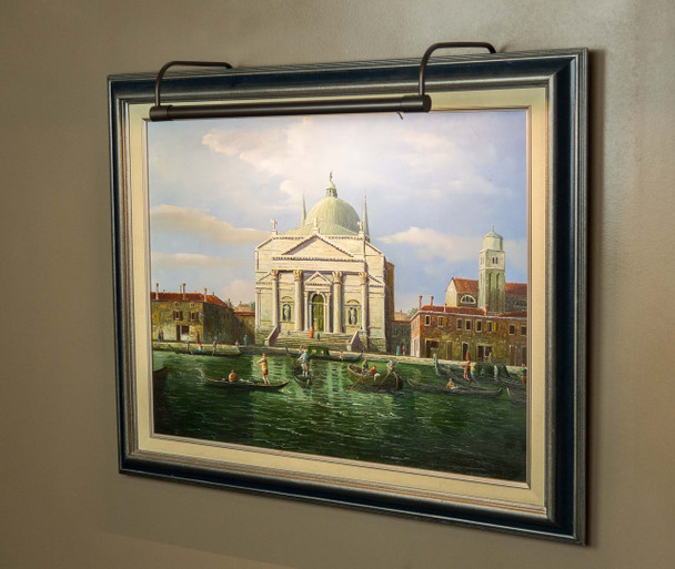 Example: Battery-Operated 16'' Tru-Slim LED Picture Light - Oil Rubbed Bronze  Mounted on Painting