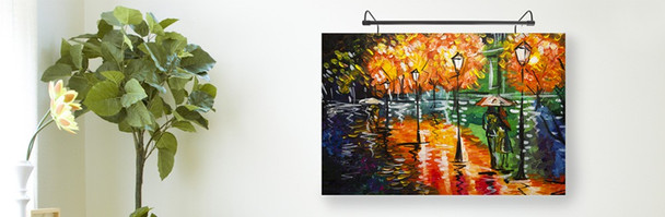 Example: Battery-Operated 16'' Tru-Slim LED Picture Light - Black Mounted on Painting in Living Room