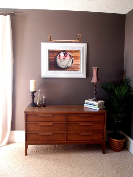 Example: Tru-Slim Hardwired LED Picture Light in Rose Gold Mounted on Painting and Living Room