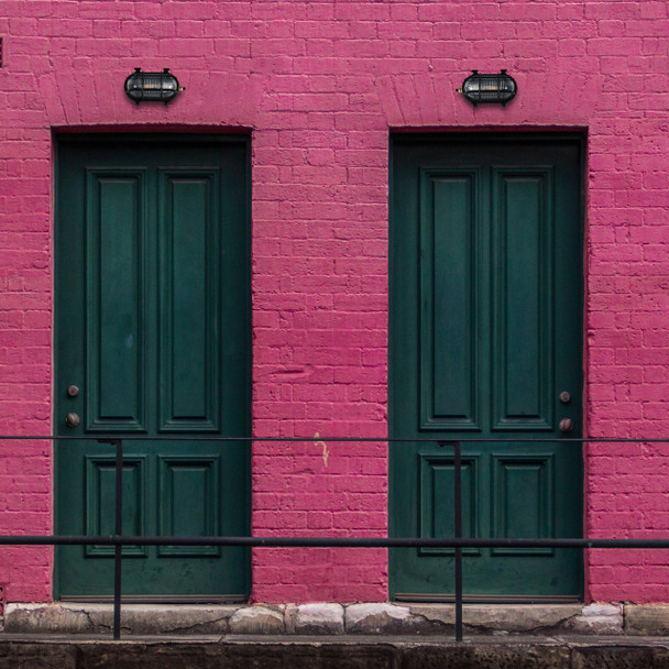 Ceduna Nautical Bulkhead Light in Black (AM-G526-BK) on pink wall over a black door