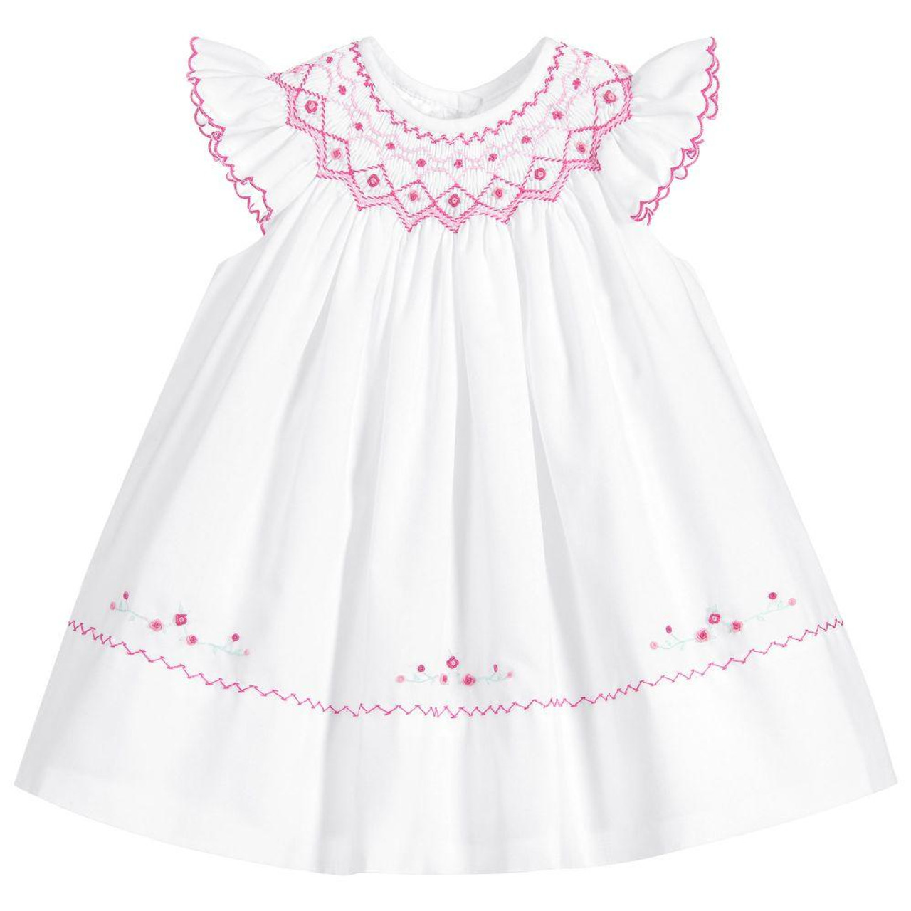 d305d4c7e0afd Sarah Louise. £47.00. Baby Girls white and Pink Smocked Dress