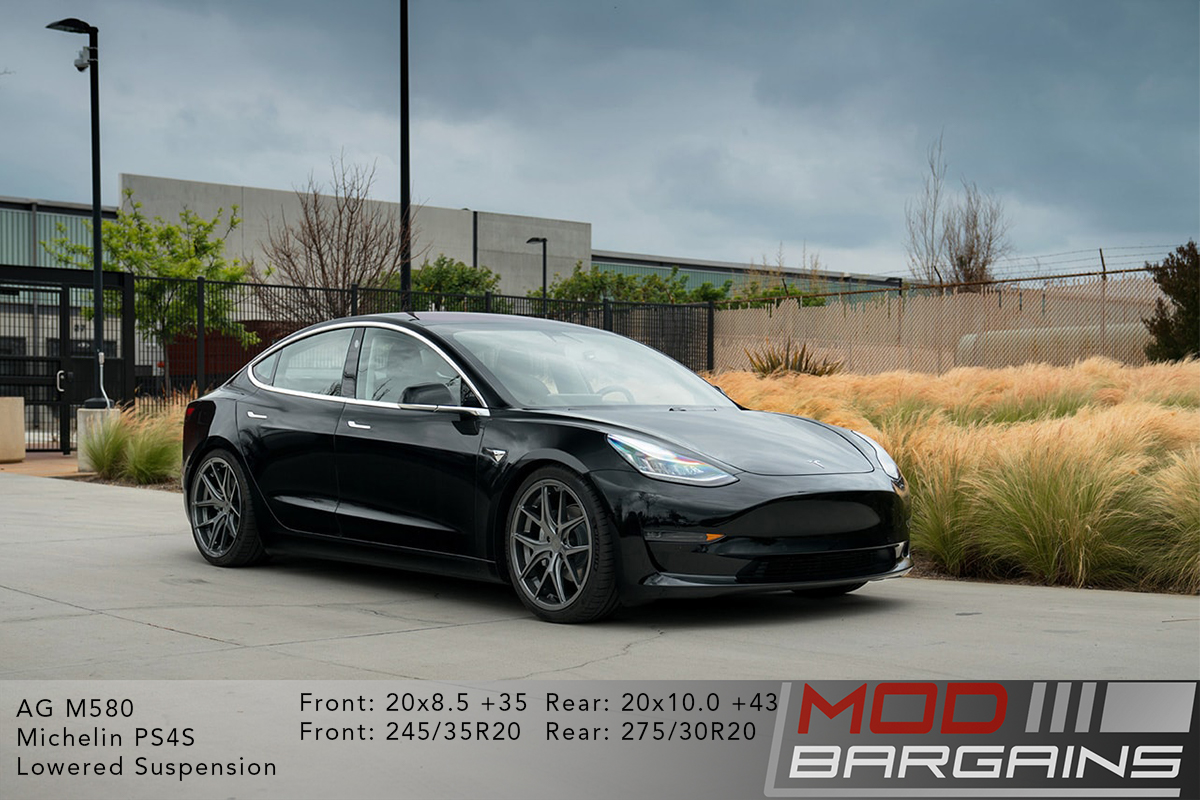 Black Tesla Model 3 on Gunmetal Avant Garde AG Wheels M580 20x8.5 front and 20x10 rear with Michelin PS4S Tires and lowered suspension