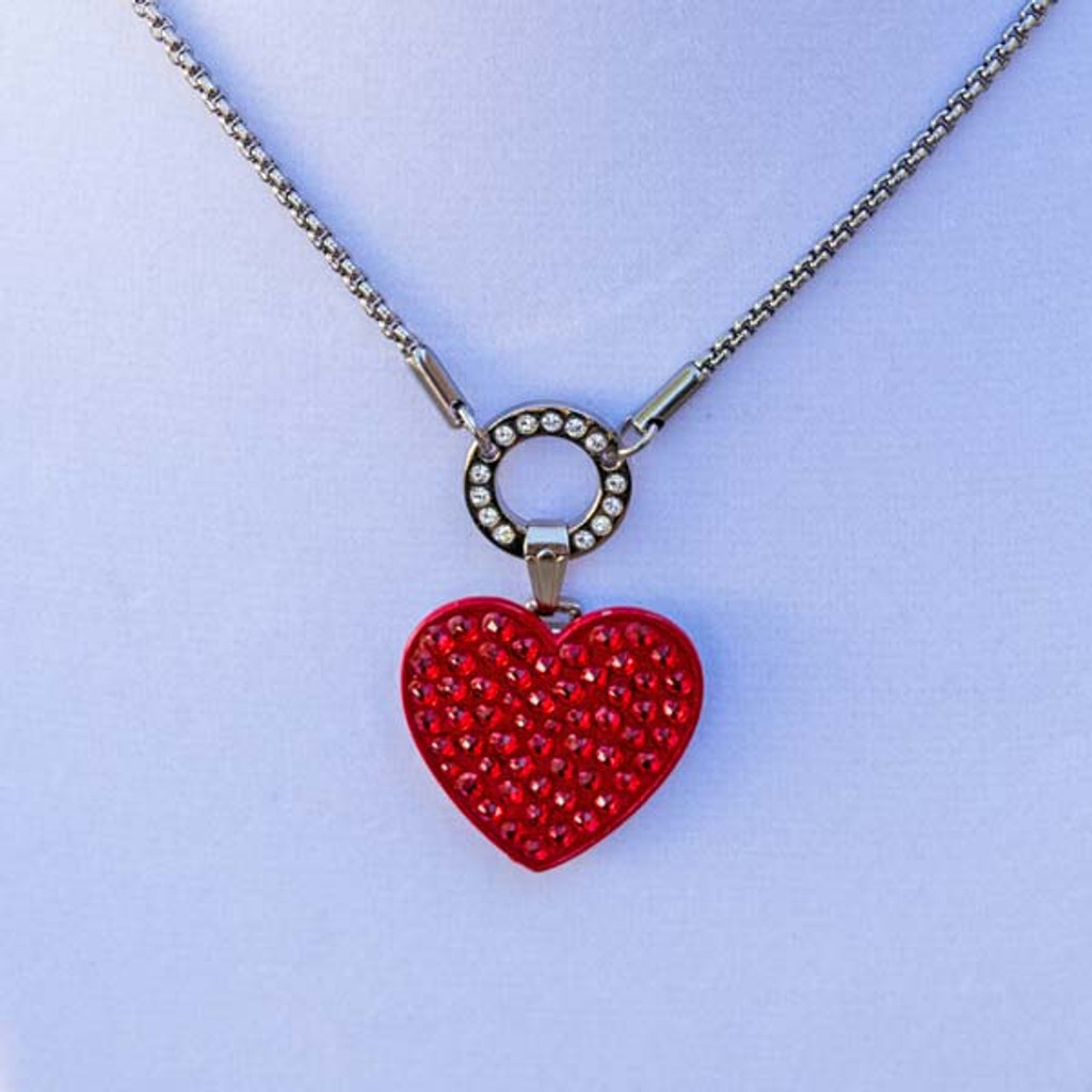 Holly's Heart Magnetic Charm is a red heart shaped charm covered in red crystals that fits into Bella's Basic Base Necklace in Avalee's Glamour magnetic collection. Pictured with Bella's Basic Base Necklace (Not Included).