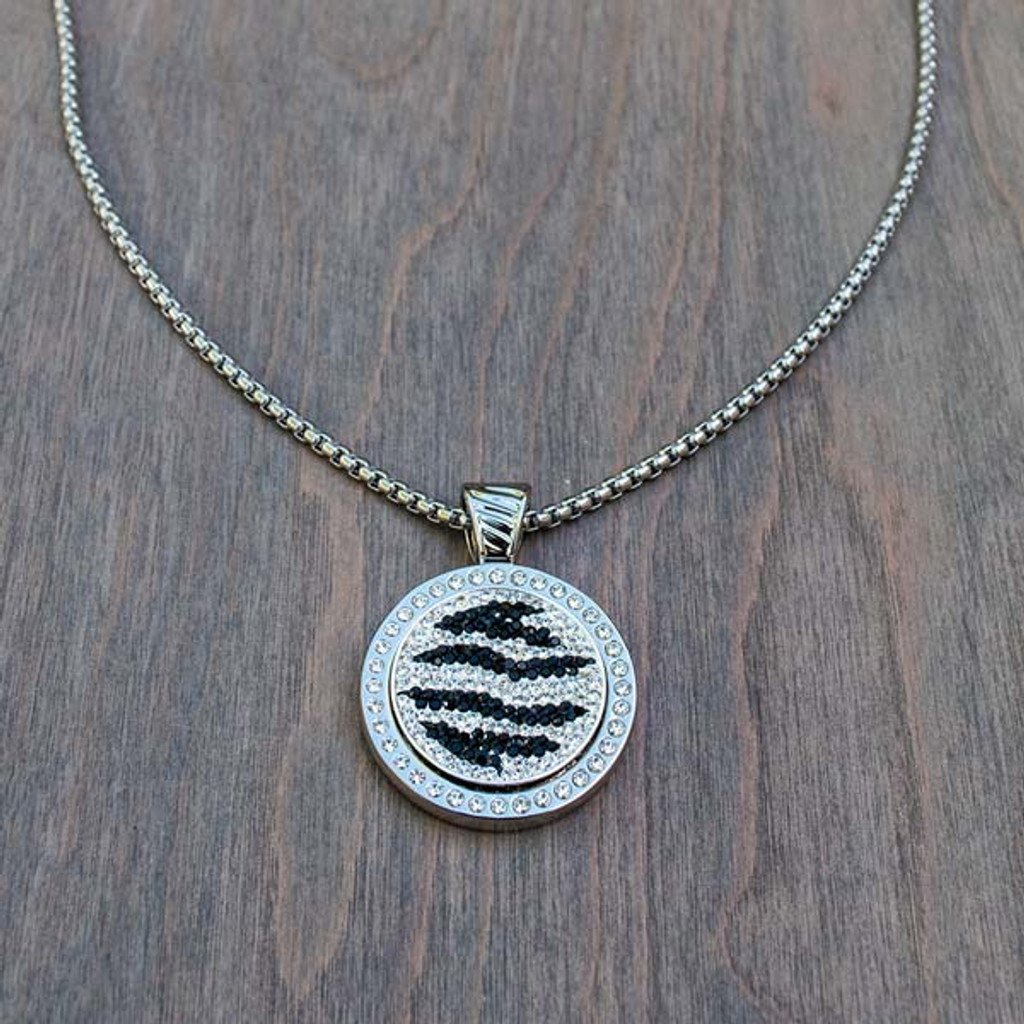 Zoe's Zebra Magnetic Charm shown in Magnolia's Magnetic Base Necklace (sold separately).
