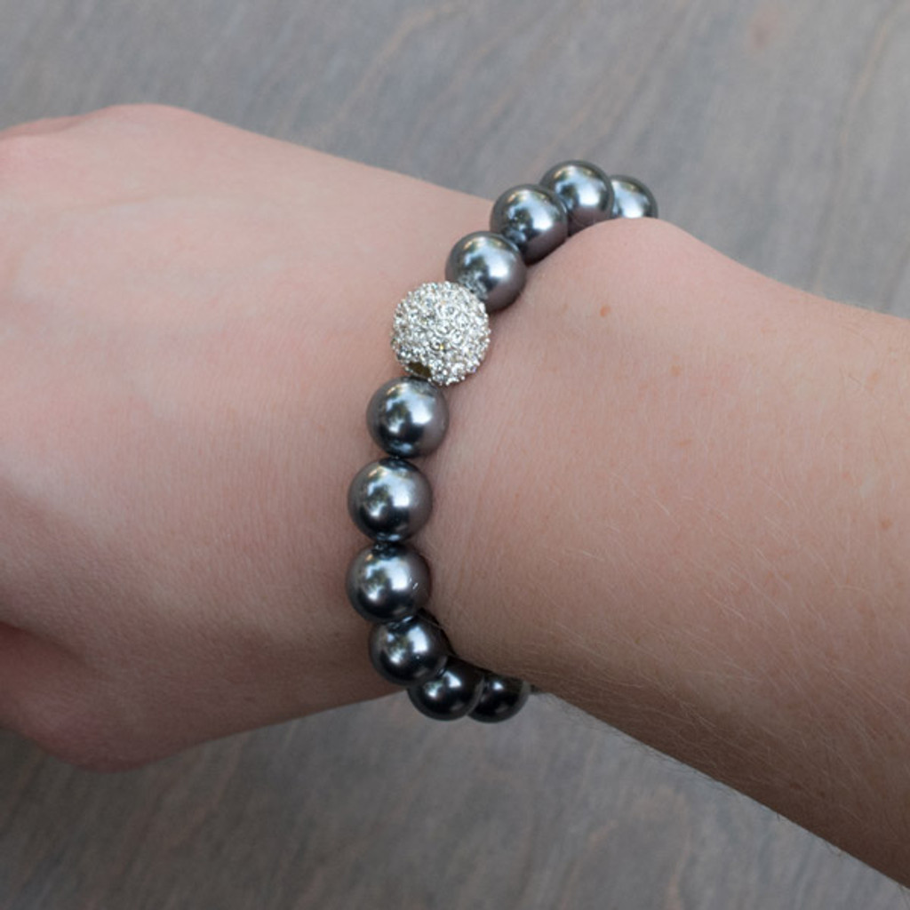 Priscilla's Black Pearl Bracelet is a stretchy black pearl colored bracelet with a Swarovski® Crystal encrusted accent bead.