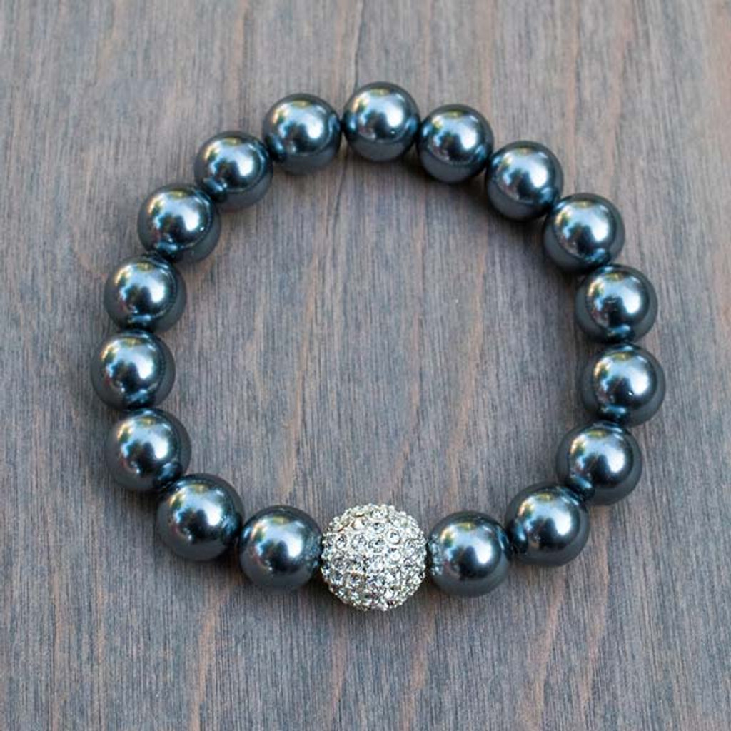 Priscilla's Black Pearl Bracelet features a Swarovski® Crystal encrusted accent bead and 10mm black pearl colored beads.