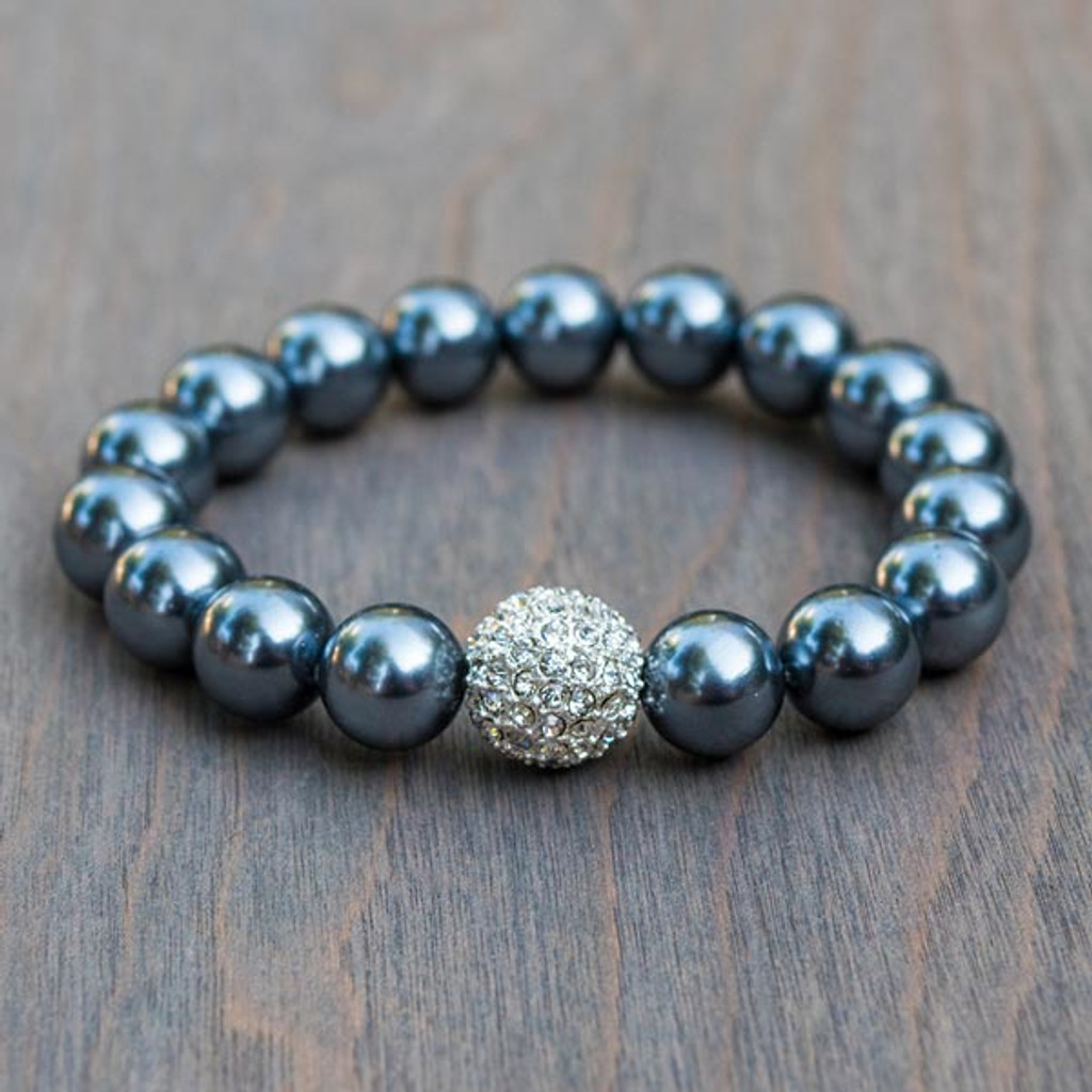 Priscilla's Black Pearl Bracelet is a 10mm black pearl colored bracelet with a Swarovski® Crystal encrusted accent bead.