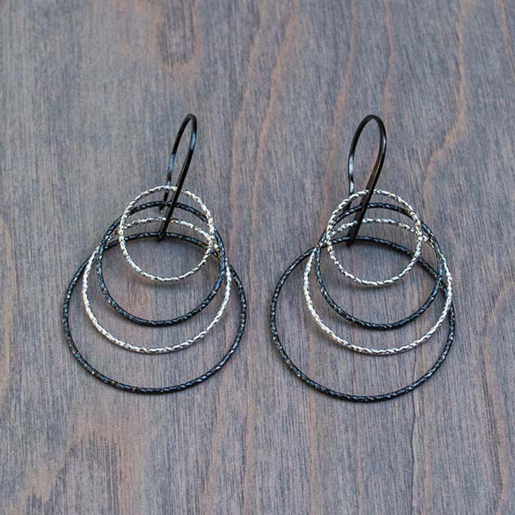 Heather's Hoops Earrings featured by Avalee's Glamour. These beautiful earrings are sterling silver with four black and silver hoops that dangle from the hooks.
