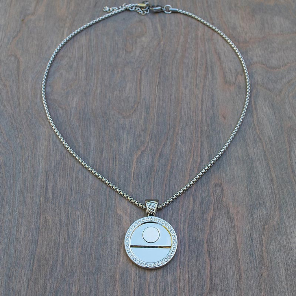 "Magnolia's Magnetic Base has a 25mm round pendant encircled with clear crystals and features a stainless steel chain available in 16"", 20"" or 30"" length."