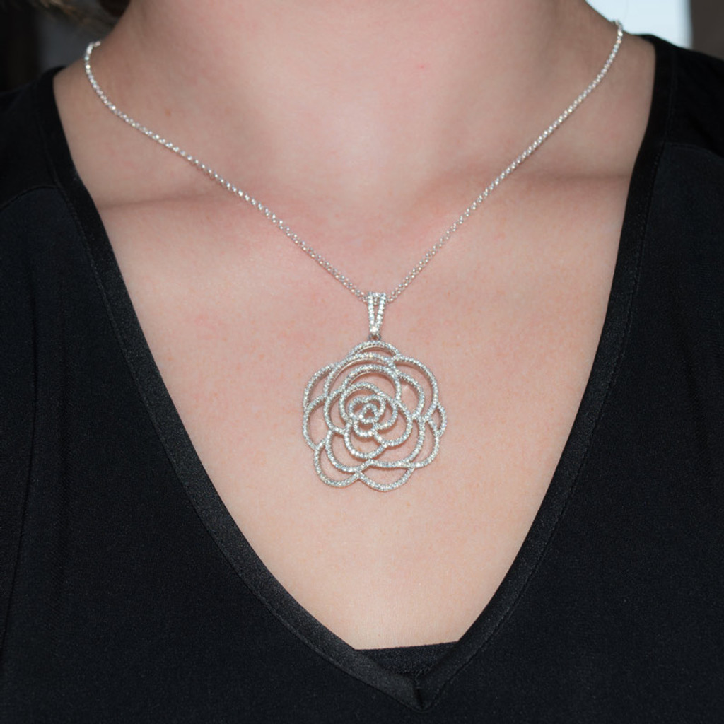 Beautiful Pave Crystals and Sterling Silver make up this stunning Rose shaped pendant necklace.