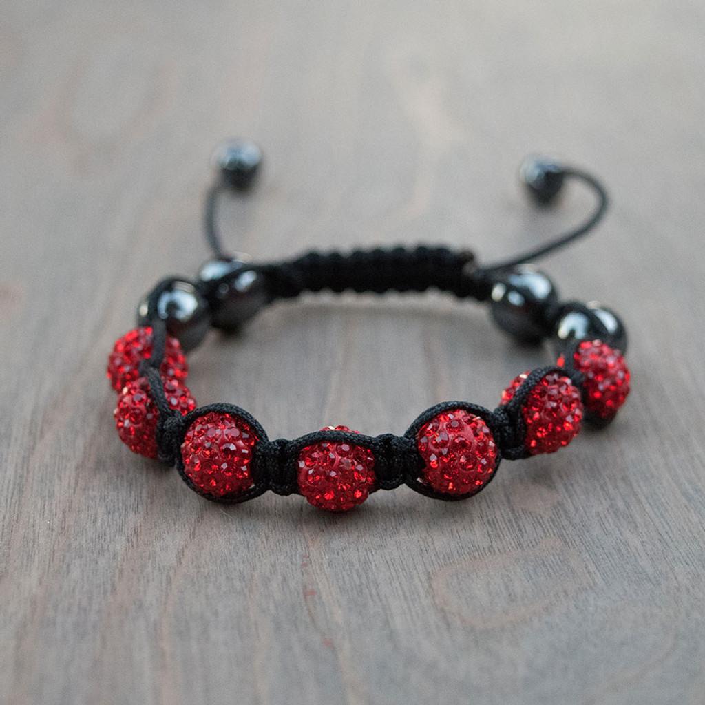 Ruby's Red Shamballa Bracelet is a Swarovski crystal encrusted beaded bracelet on a woven nylon band.