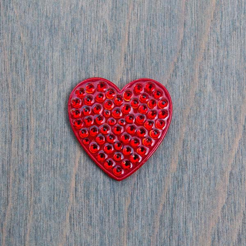 Holly's Heart is a red heart shaped magnetic charm covered in red crystals. It is part of the Avalee's Magnetic Collection and fits on Bella's Base Necklace (sold separately).