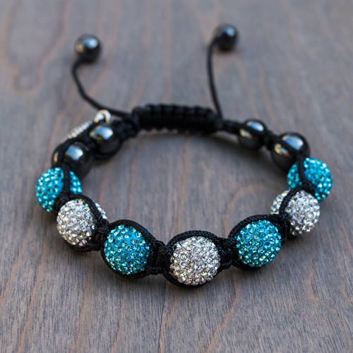 Brittany's Blue Disco Bracelet is a blue and white shamballa style bracelet that adjusts to almost any size wrist.