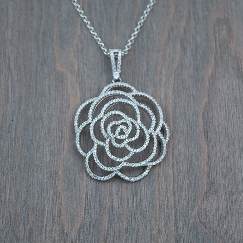 Raphaela's Sterling Silver Rose Necklace is a Sterling Silver Rose Pendant on a sterling silver chain.