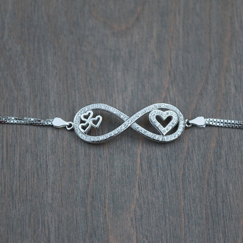 Crystal embellished sterling silver infinity symbol with hearts.
