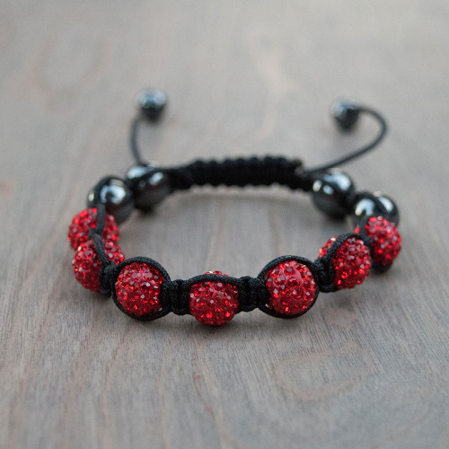 Ruby's Red Shamballa Bracelet is a Swarovski crystal encrusted beaded bracelet on a woven nylon band.
