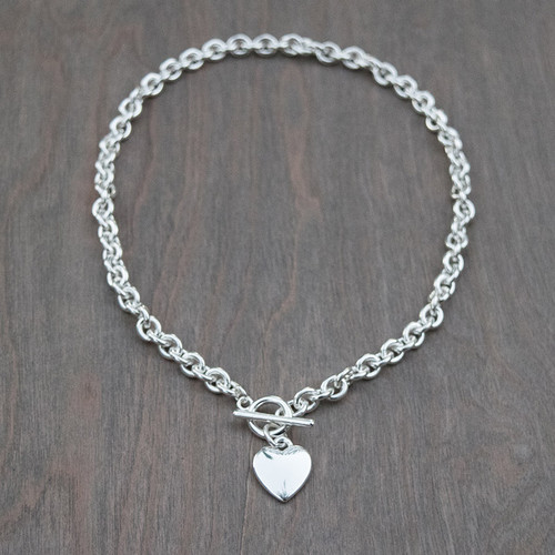 Hailey's Heart Link Necklace is a heavy weight sterling and titanium link necklace with a toggle clasp and heart charm.