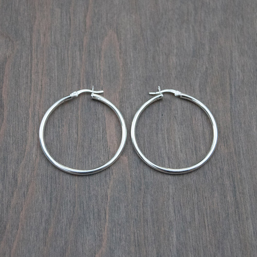 Heather's Large Sterling Silver Hoop earrings with sterling silver clasps.