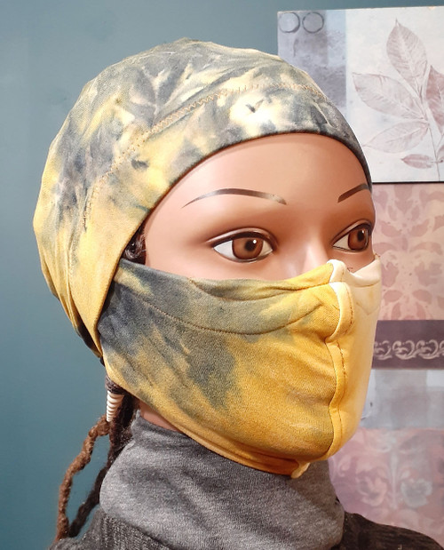 (color placement may vary) Made of a soft knit fabric. Arrives complete with stay on ponytail cap and matching face covering mask.  If you have been Looking for a cap that stays on your head then The Stay On Pony Cap is the choice for you. It ties on securely, while putting your hair in a ponytail as well. It looks and feels amazing. Simply place the cap on your head with the elastic going across the front of the head as usual. Then bring the draw strings along the bottom of your hair in the back to create a ponytail. Tie it off to your level of comfort. (It's just like tying your shoe string)