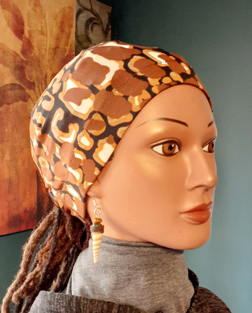 Print placement may vary. fabric in the standard 20 inch circumference around the head.   Looking for a cap that stays on your head even when you sleep? The Stay On Pony Cap is the choice for you. It ties on securely, while putting your hair in a ponytail as well. It looks and feels amazing. Simply place the cap on your head with the elastic going across the front of the head as usual. Then bring the draw strings along the bottom of your hair in the back to create a ponytail. Tie it off to your level of comfort. (It's just like tying your shoe string) Ships priority mail to addresses in the U.S.