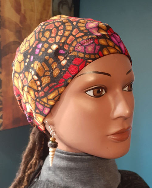 This stay on ponytail cap is made of a spandex fabric in the standard 20 inch circumference around the head. If you have been Looking for a cap that stays on your head even when you sleep then The Stay On Pony Cap is the choice for you. It ties on securely, while putting your hair in a ponytail as well. It looks and feels amazing. Simply place the cap on your head with the elastic going across the front of the head as usual. Then bring the draw strings along the bottom of your hair in the back to create a ponytail. Tie it off to your level of comfort. (It's just like tying your shoe string) Ships priority mail to addresses in the U.S.