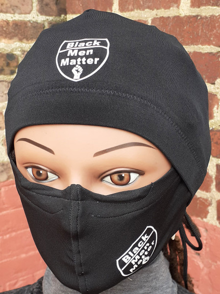 """Black Knit fabric. Both the cap and mask are Imprinted with the phrase """"Black Men Matter"""" and there is a Black Power Fist Imprinted in white. Arrives with the standard 20 inch head circumference size. Mask is washable and adjustable.  Looking for a cap that stays on your head even when you sleep? The Stay On Pony Cap is the choice for you. It ties on securely, while putting your hair in a ponytail as well. It looks and feels amazing. Simply place the cap on your head with the elastic going across the front of the head as usual. Then bring the draw strings along the bottom of your hair in the back to create a ponytail. Tie it off to your level of comfort. (It's just like tying your shoe string) Ships priority mail to addresses within the U.S"""