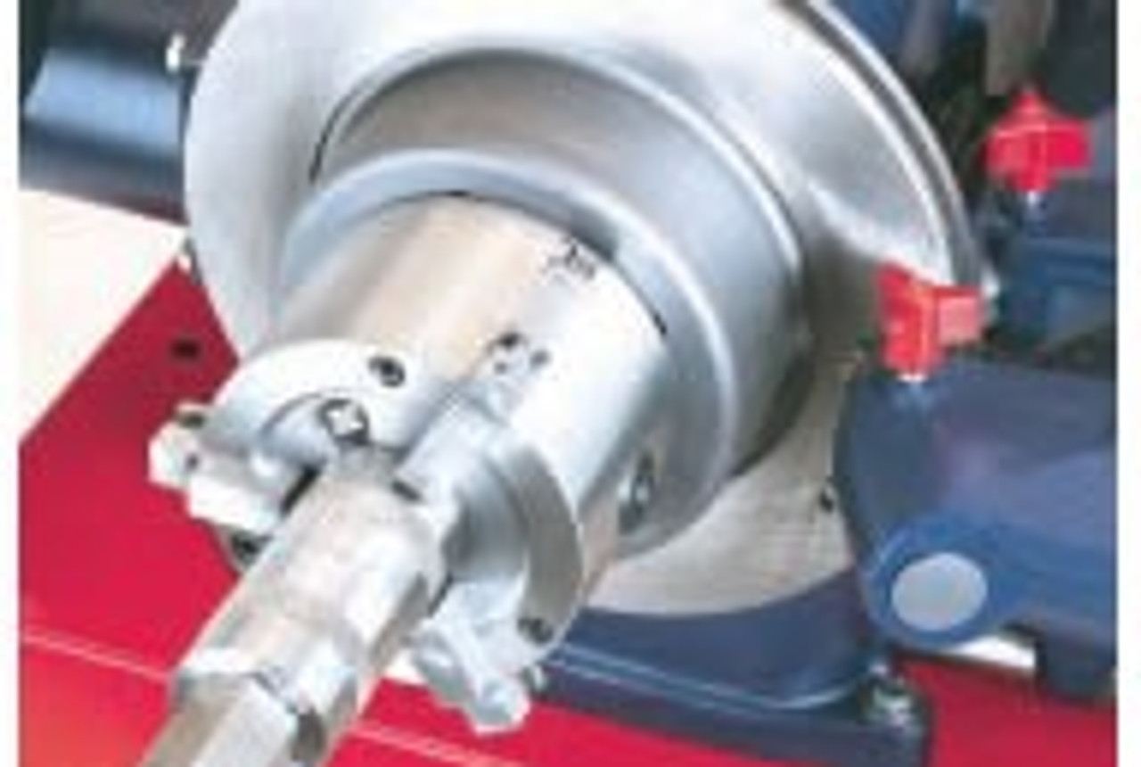 Hub-less Rotor mounted on Ammco Brake Lathe with 2-sided Brake Lathe Chuck.