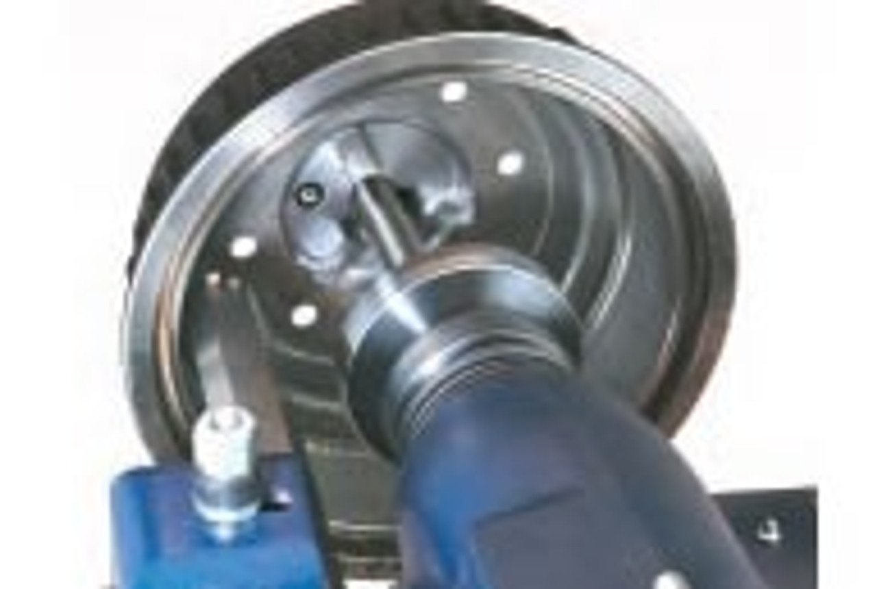 Hub-less Drum mounted on Ammco Brake Lathe with  Brake Lathe Chuck.