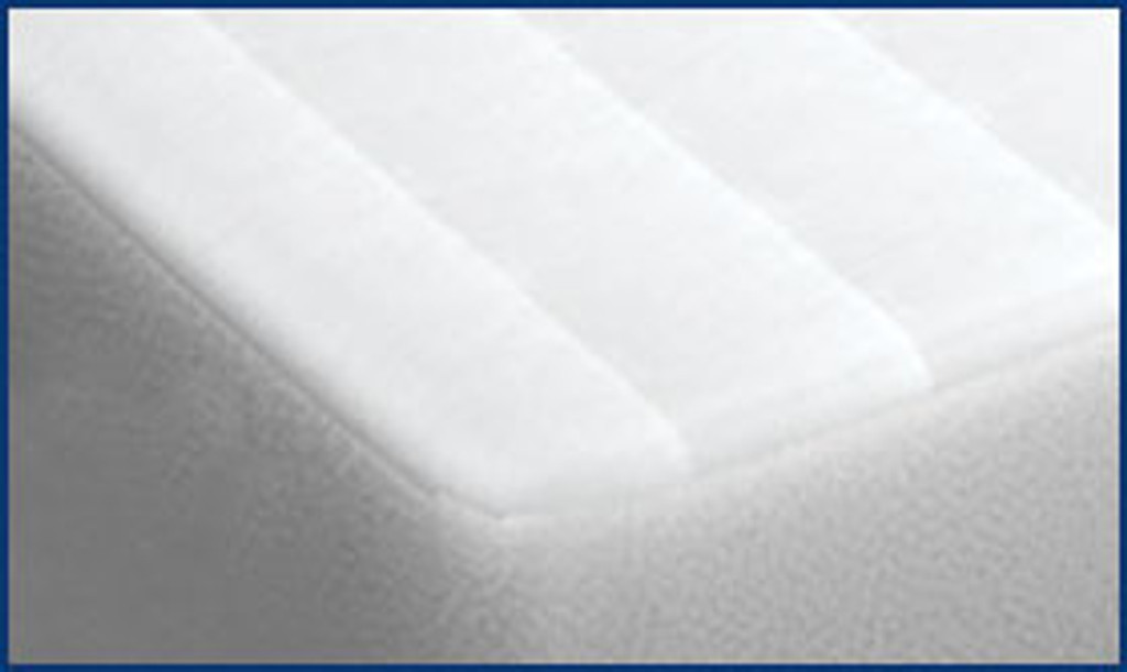 Cotton Fitted Pad on Bed
