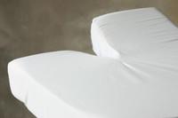 Split Head sheet on a mattress
