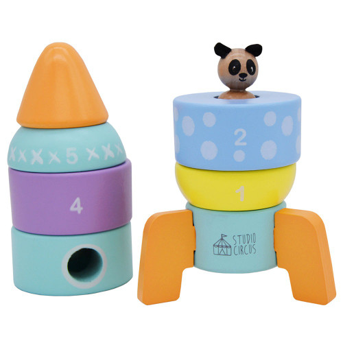 The rocket tower toy with top half removed to reveal wooden character inside