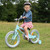 Young girl riding the vintage bicycle