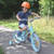 young boy rides vintage bicycle outdoors