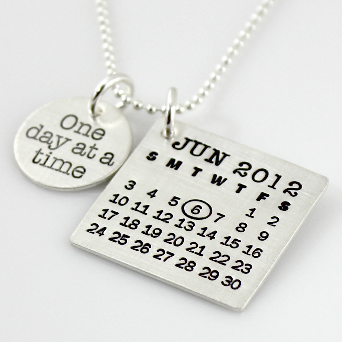 Mark Your Calendar Necklace with 'One day at a time' Charm