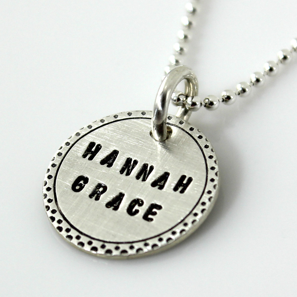 Fancy Border Name Charm stamped in all caps gothic